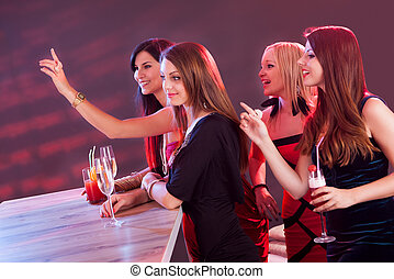 Beautiful girls ordering drinks at the bar - Young girls...