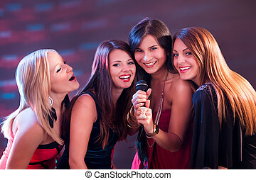 Four beautiful girls singing karaoke - Four beautiful...
