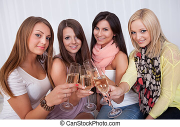 Girls toasting with champagne