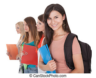 Four female students in a row