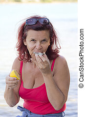 Woman eating fresh oyster