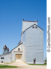 Grain Elevator - A large grain elevator shot against a blue...