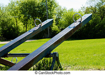 Teeter Totter - Two teeter totters saturated with color,...