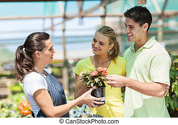 young couple buying flowers