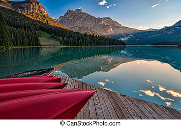 Canoe Dock with Mountain Reflection - The sun lights the...