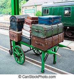 Luggage on porter's trolley on railway platform circa 1950...
