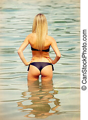 Attractive blond woman on the water
