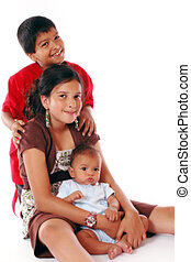 Siblings - Portrait of three biracial siblings