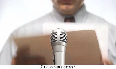 press conference, microphone and spokesman