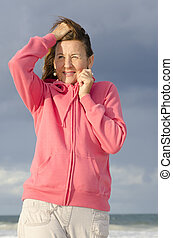 Lonely mature woman ocean background - Attractive senior...