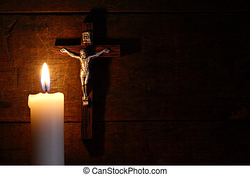 Night Prayer - Small crucifix hanging on old wooden wall...