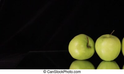 Green Apples on Black - A pile of juicy ripe apple on black...