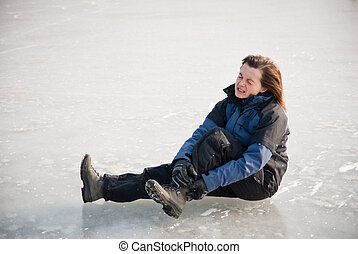 Ankle injury - winter slip - Young woman with ankle injury...