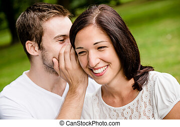 Tell me secret - whisper - Young man whispering to woman...