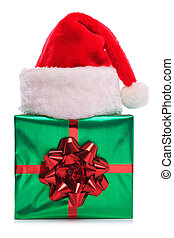 Santa Claus hat and gift wrapped present - Photo of a Santa...