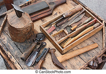 old tools of the shoemaker - work table with old tools of...