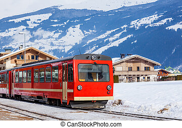 Red train in Austria - The red train on the Alpine skiing...