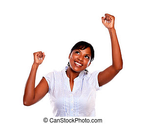 Afro-american young woman celebrating a victory on isolated...