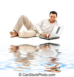 relaxed man with laptop on white sand - relaxed man with...