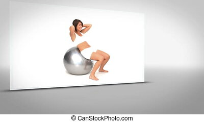 Clip of woman on exercise ball on grey background with...