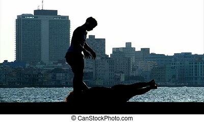 Sport on Malecon Havana Cuba - Siluette of people duing...
