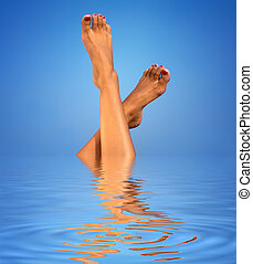legs in blue water - picture of female legs in blue water