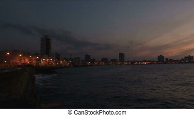 Panning from City to Sea during Sunset on Malecon Havana...