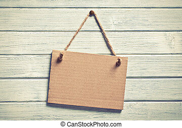 paper board hanging on wooden wall - the paper board hanging...