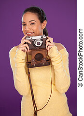 Happy photographer with vintage camera