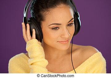 Beautiful woman listening to music - Beautiful woman wearing...