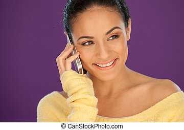 Beautiful woman listening to her mobile