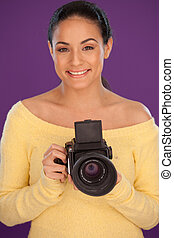 Smiling woman with vintage camera