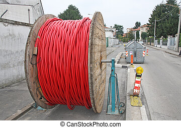 spool of cable and fiber optics in the road during the...