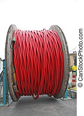 reels with red cord coiled ready to be laid underground