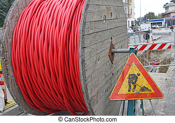 roadworks and a coil of wire with the road sign signaling of...
