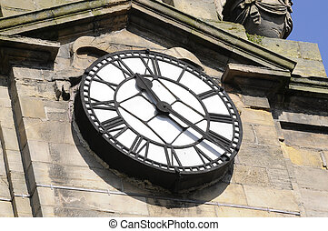 Old church clock in Inverness, Scotland at 11:25 in the...