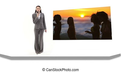 Woman reporting on fun at the beach - Woman in suit...