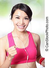 sport woman running and listen music