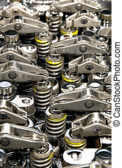 Close up of parts in engine head 4 valve system