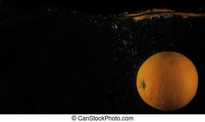 Fresh Orange Falling into Water