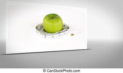 Clip of apple surrounded by measuring tape on white...