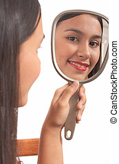 girl holding mirror on a white background