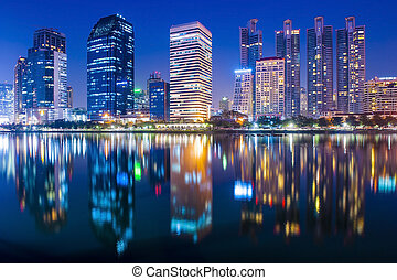 Bangkok city downtown at night with reflection of skyline,...