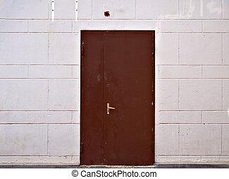 Rusty Metal Door stock photos of rusty metal door in an abandoned warehouse - old