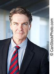 portrait of a mature businessman - portrait of a confident...
