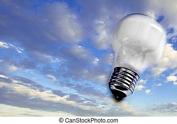 lightbulb floating on serene blue sky