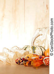 Festive Fall Arrangement - A group of gold and orange fall...