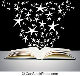 Open book and bright stars - An open book on a grey table...