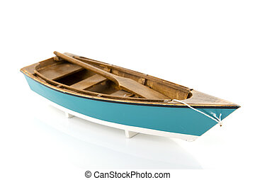 Blue rowing boat isolated over white background