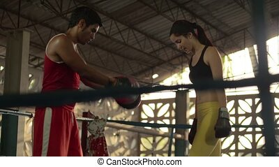 Young woman boxing, self defense - Young woman exercising...